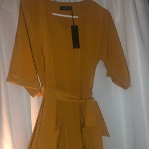 Below the knee length orange Roolee dress